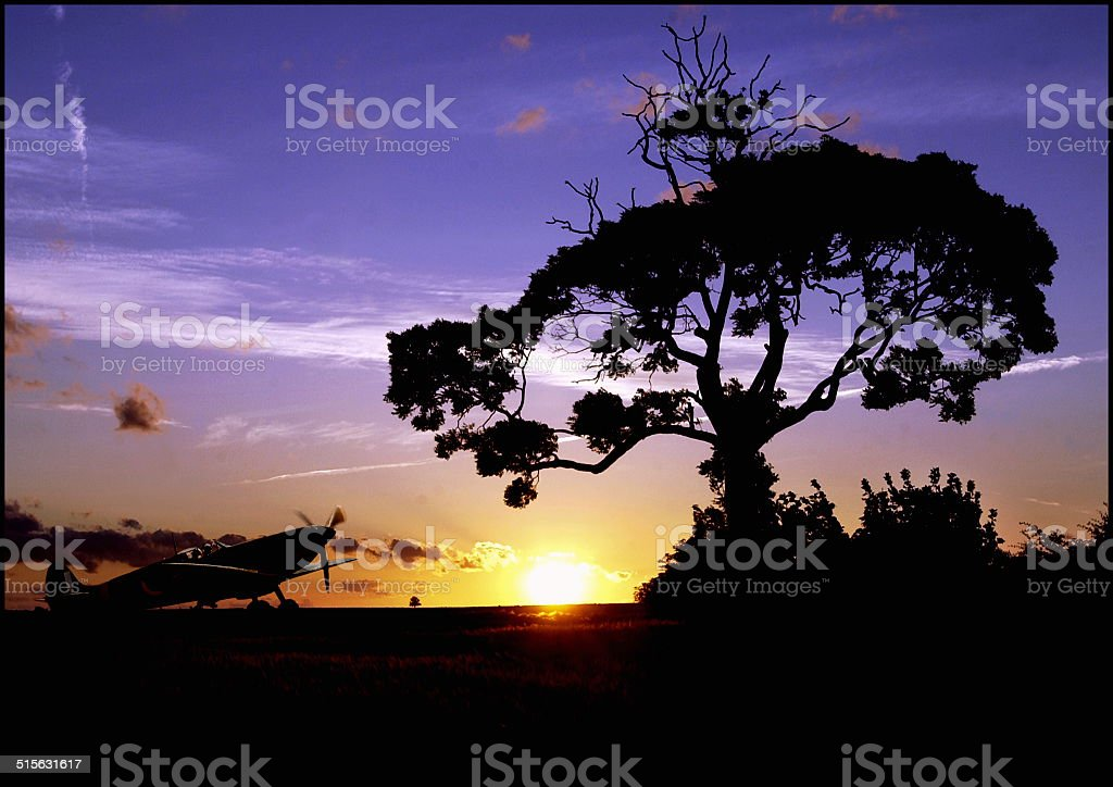 RAF Battle of Britain Memorial Flight Spitfire silhouetted against sunset stock photo