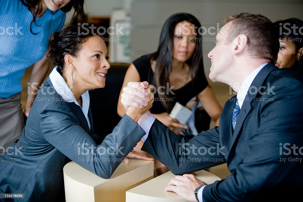 Battle of the Sexes: Arm Wrestling royalty-free stock photo