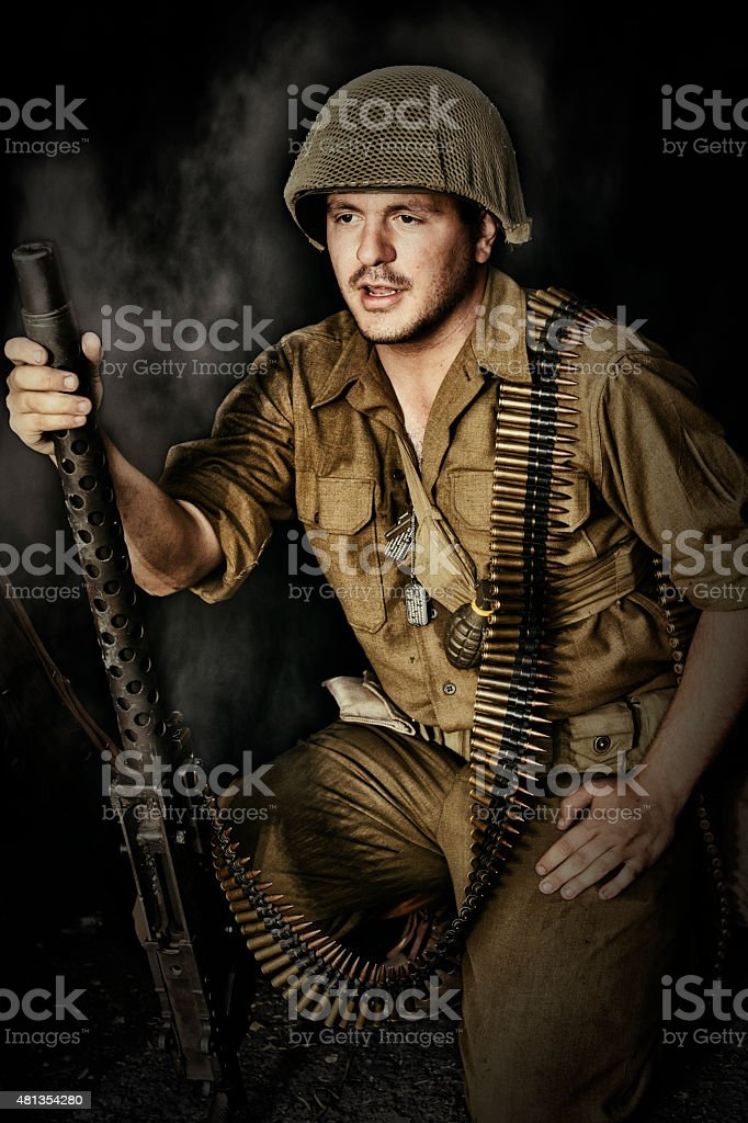 Battle Ready WWII US Soldier With 30 Caliber Machine Gun stock photo