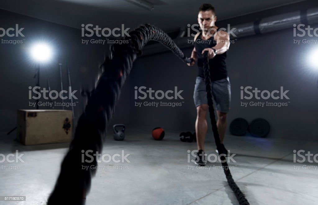 Battle ropes exercise in the garage stock photo