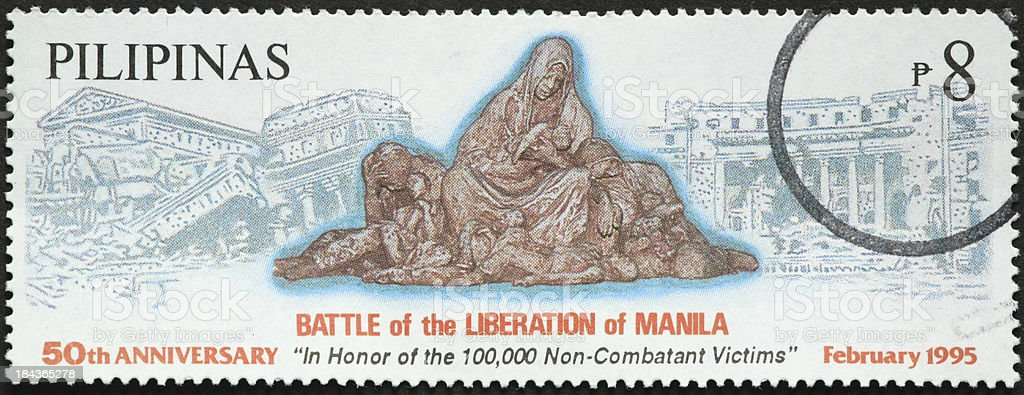 battle, the Liberation of Manila monument on a Philippines stamp royalty-free stock photo