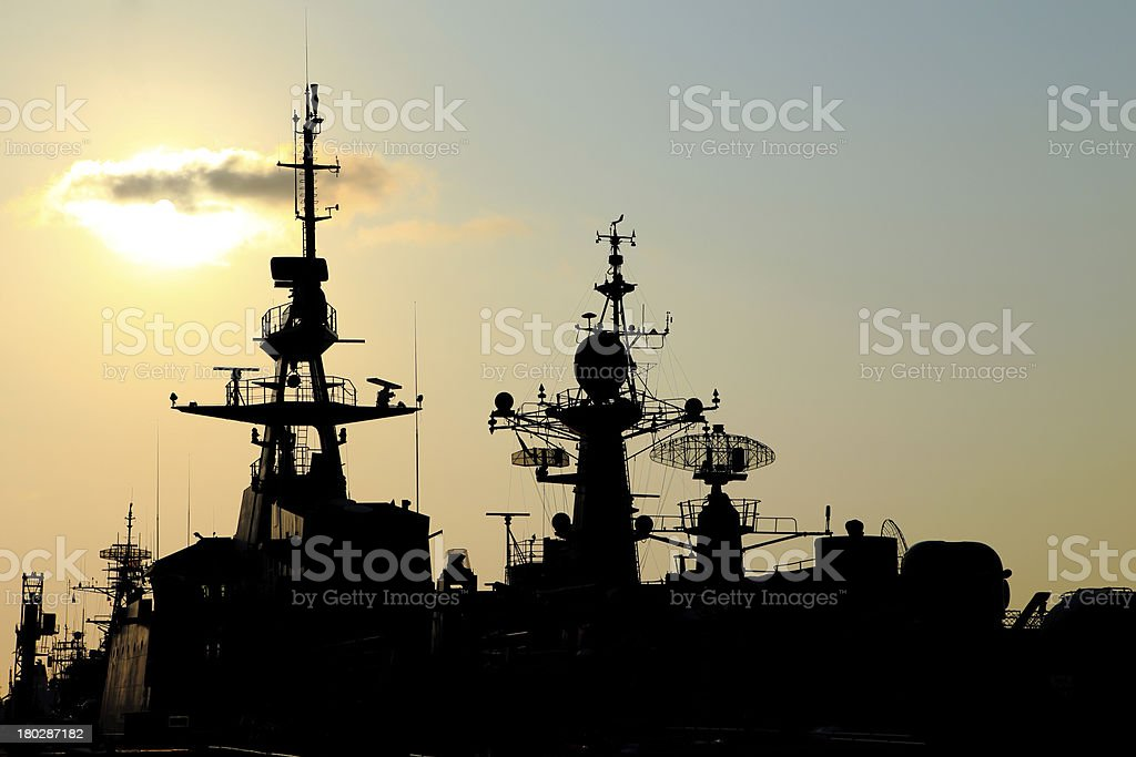 battleship with sunset behind royalty-free stock photo