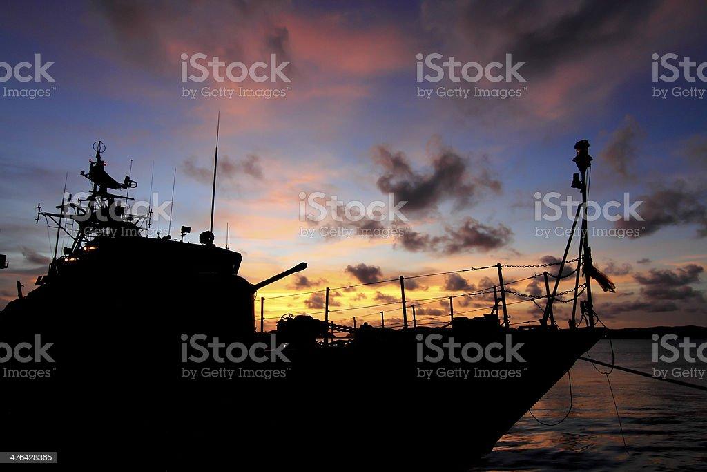 battleship with sunset behind royalty-free stock photo