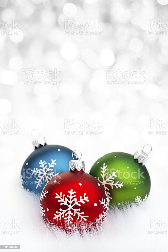 RGB baubles on snow royalty-free stock photo