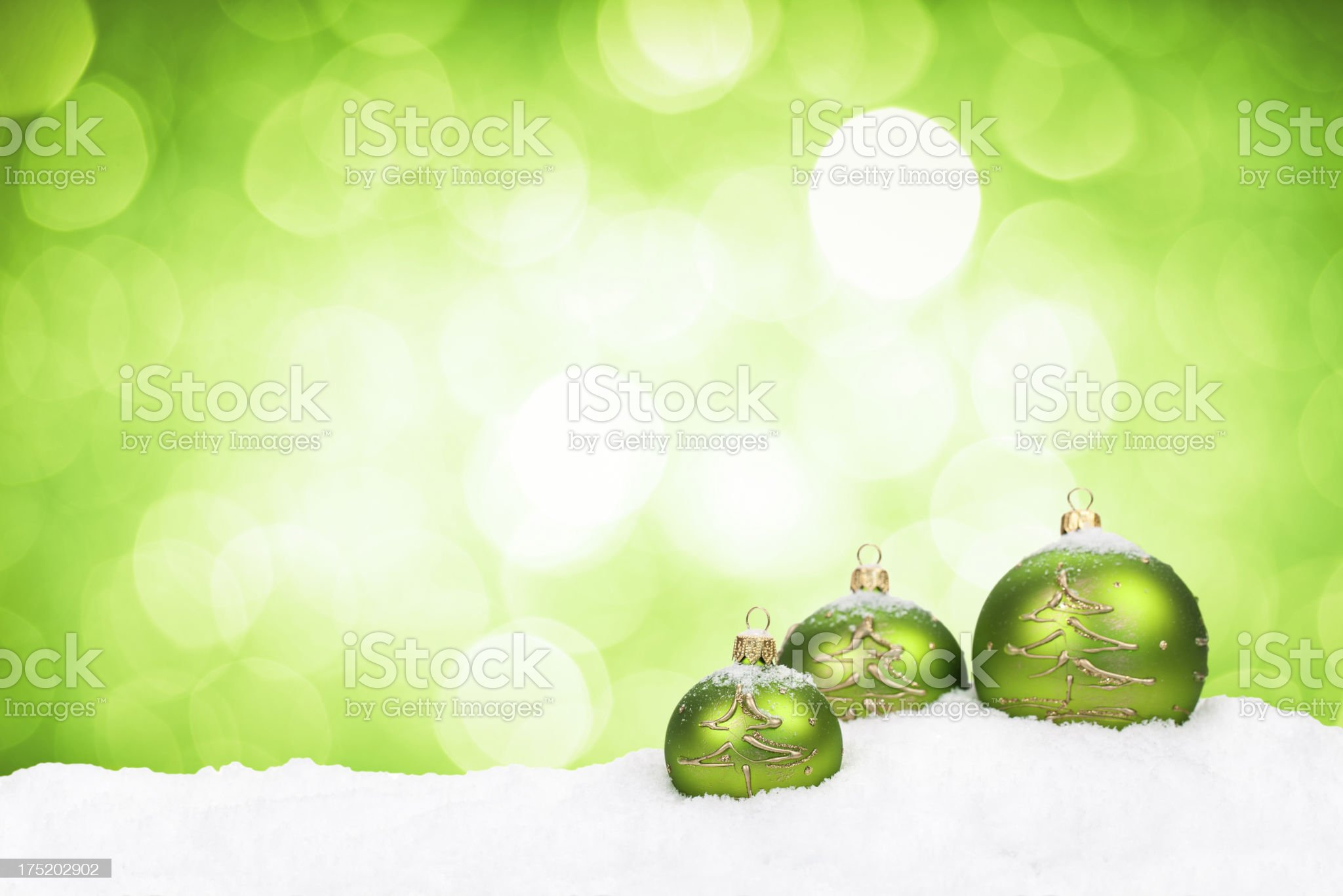 Baubles with decoration of Christmas trees lie on the snow royalty-free stock photo