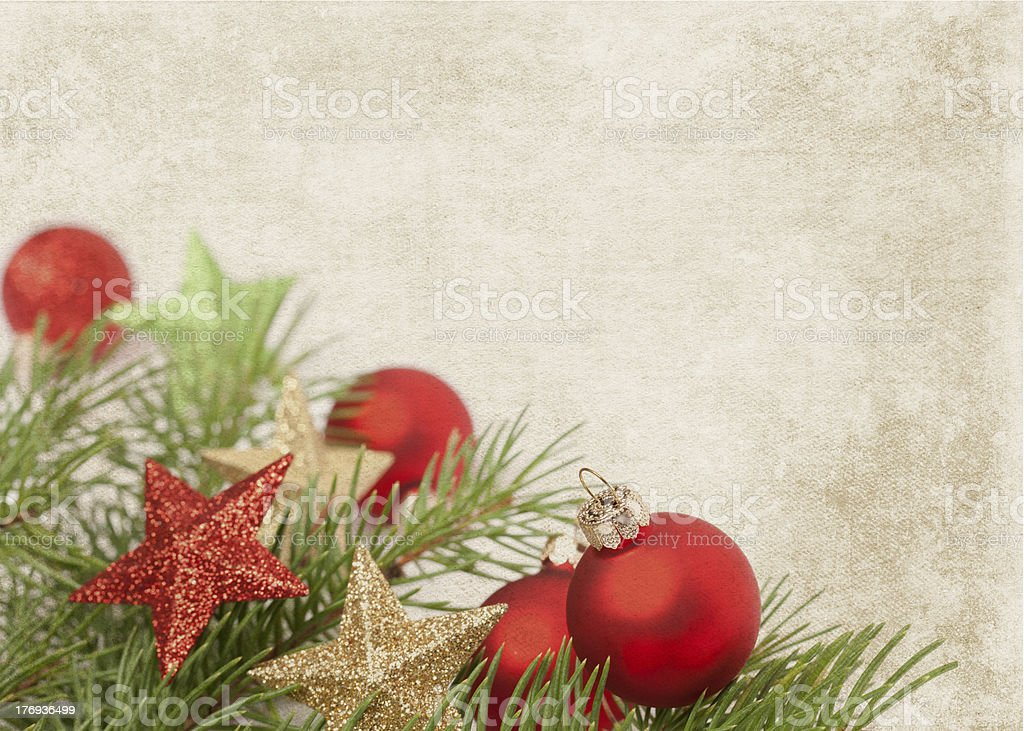 Baubles with stars and pine on a textured background royalty-free stock photo