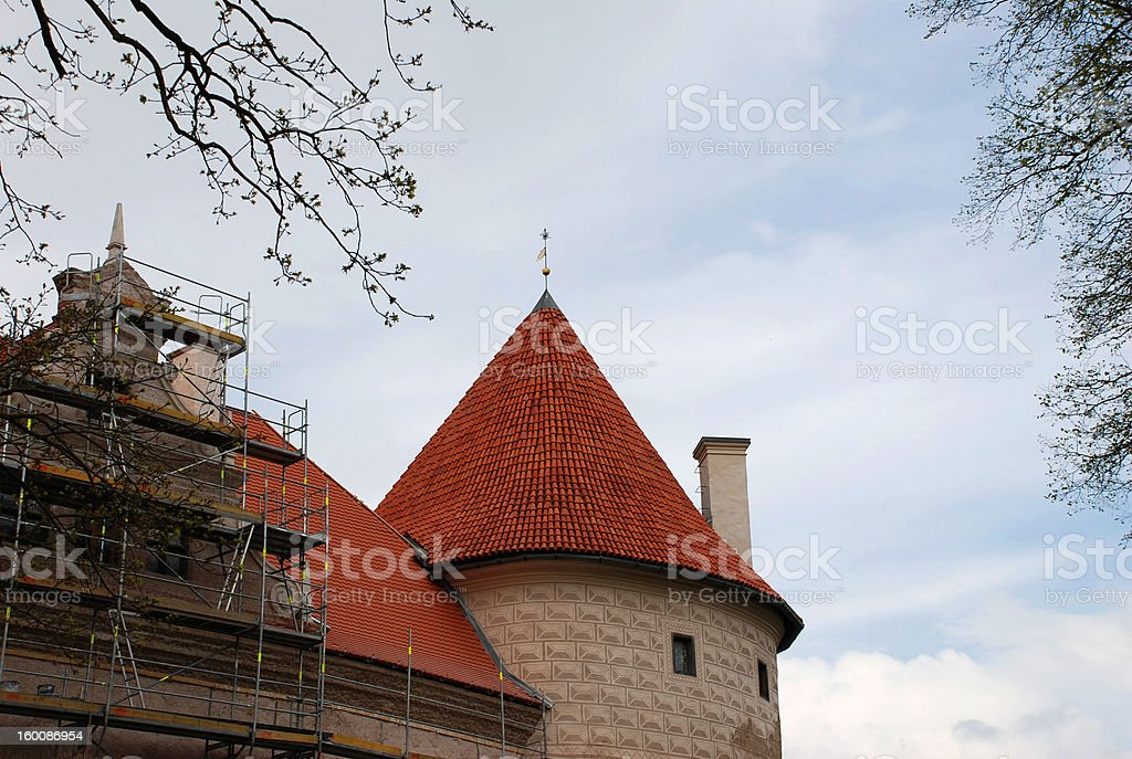 Bauska castle with tile roof royalty-free stock photo