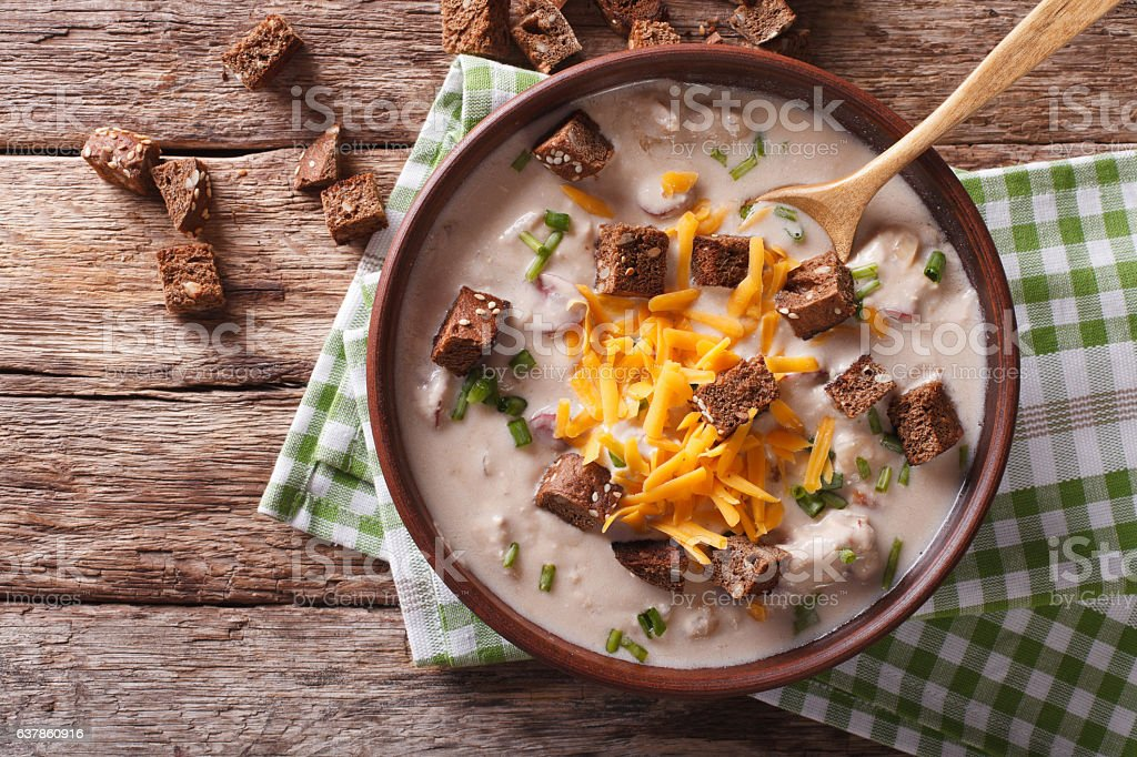 Bavarian beer soup with cheese and bacon closeup in bowl stock photo