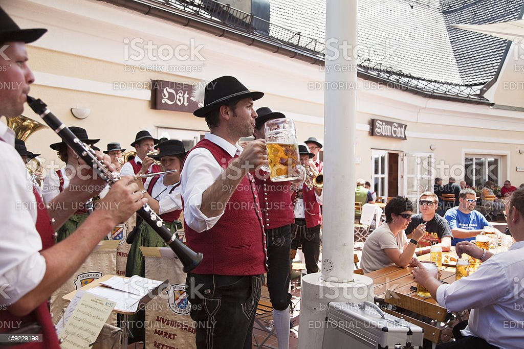 bavarian conductor raising glass of beer royalty-free stock photo