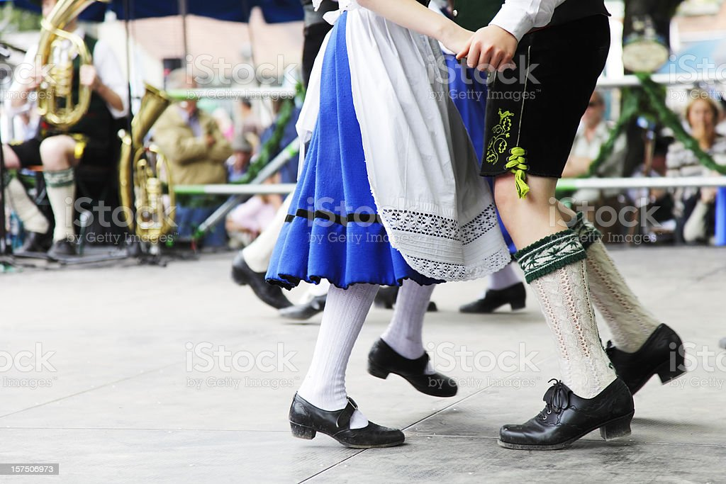 bavarian couple dancing at oktoberfest stock photo