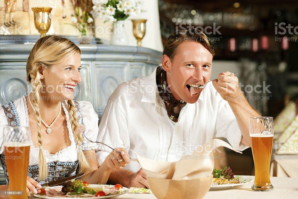 Bavarian Couple in restaurant eating stock photo