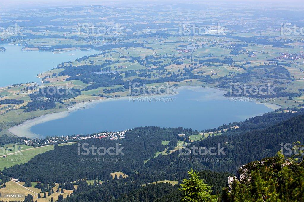 Bavarian lake Bannwaldsee from above stock photo