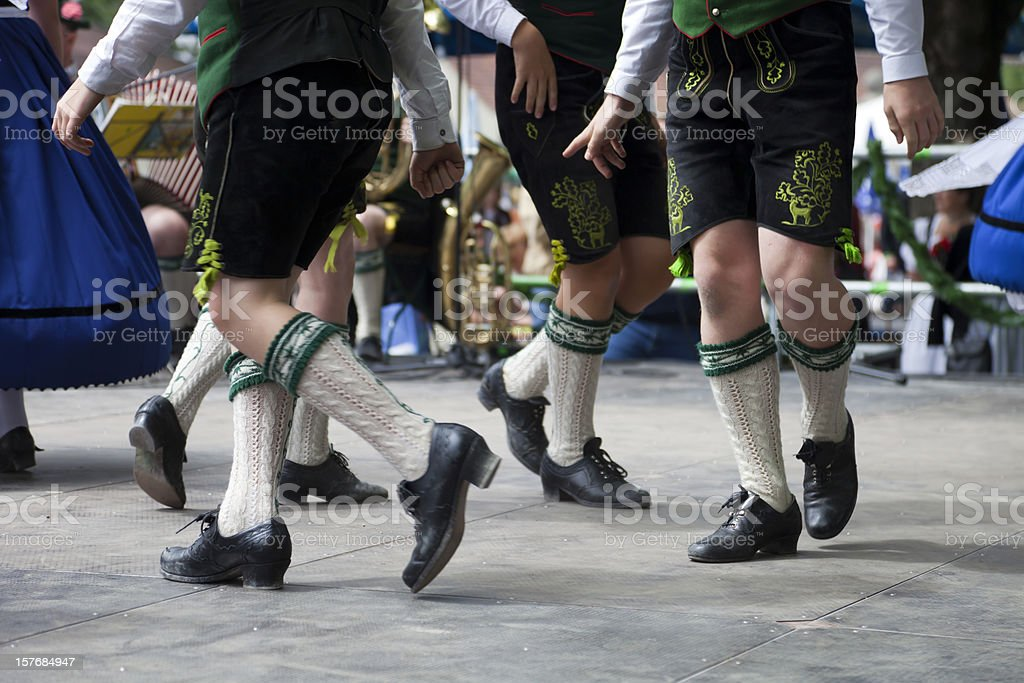 bavarian legs dancing at oktoberfest stock photo