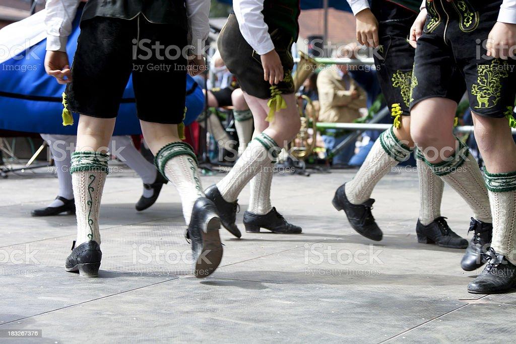 bavarian legs dancing at oktoberfest young schuhplattler royalty-free stock photo