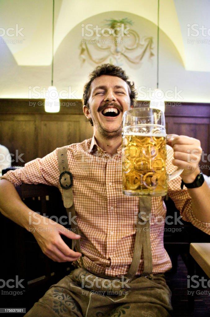 Bavarian man drunk at the Oktoberfest stock photo