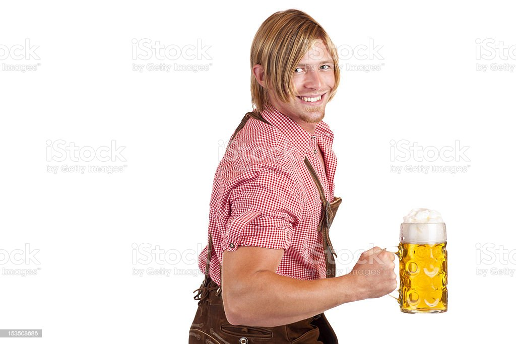 Bavarian man shows biceps muscles and holds oktoberfest beer stein royalty-free stock photo