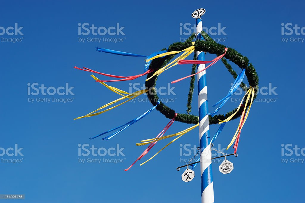 bavarian maypole against blue sky stock photo
