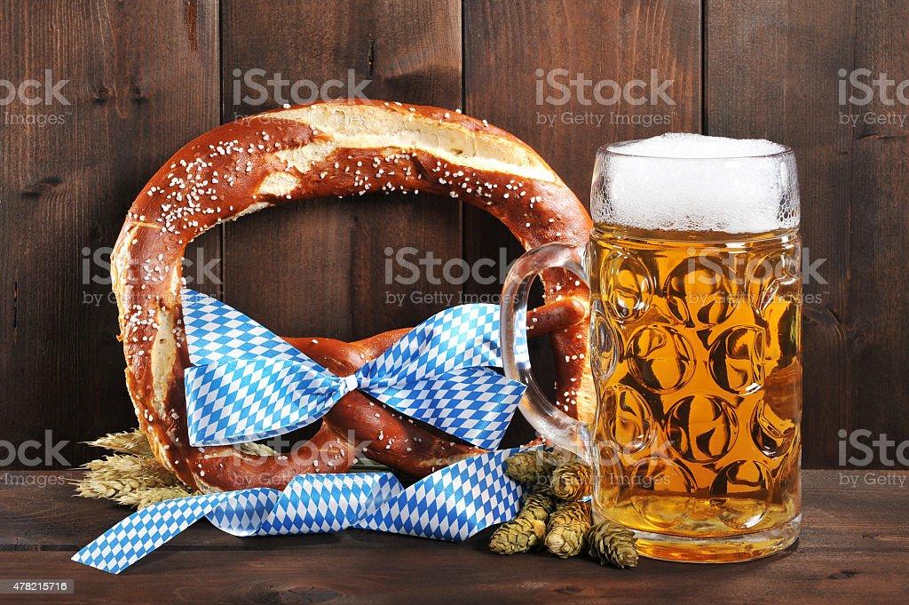 Bavarian Oktoberfest soft pretzel with beer stock photo