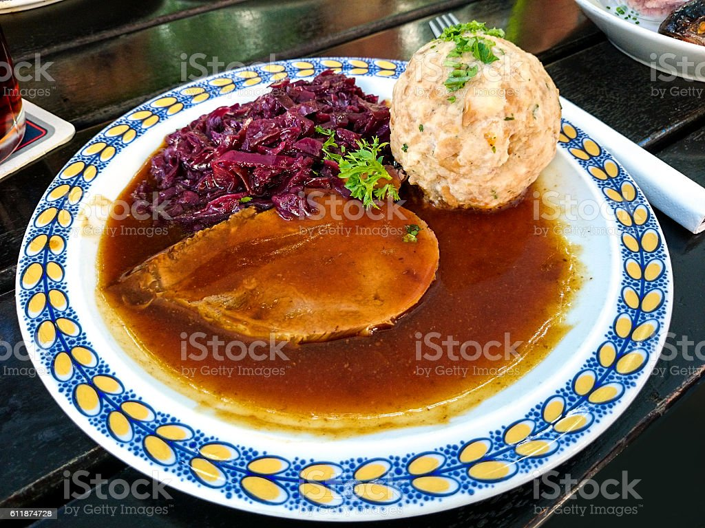 Bavarian Sauerbraten of beef, red cabbage stock photo