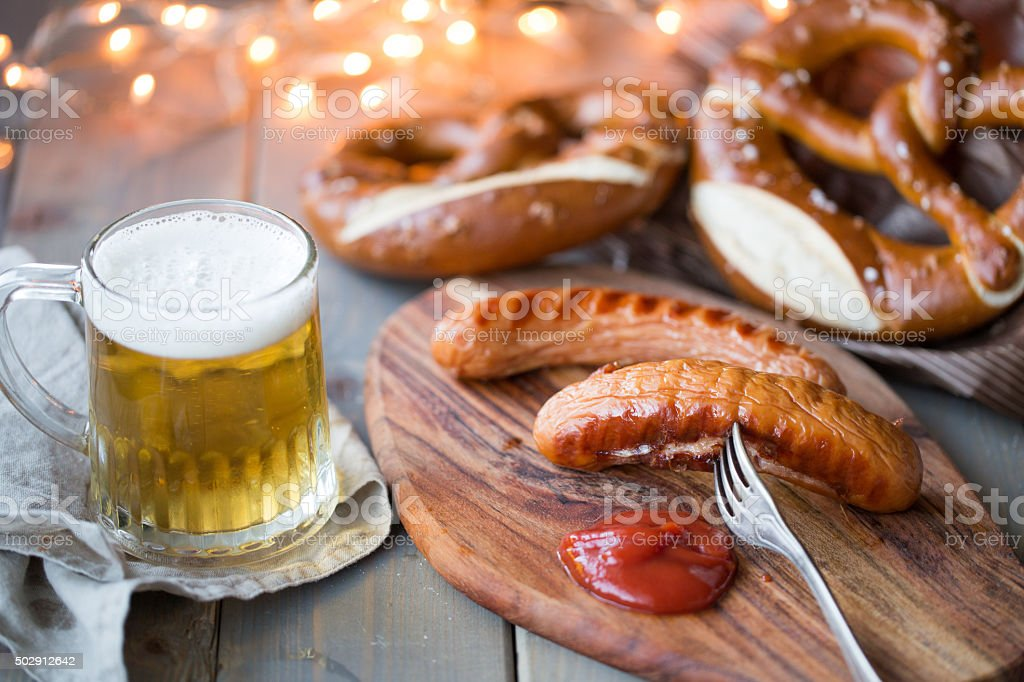 bavarian sausages with bretzel and beer stock photo