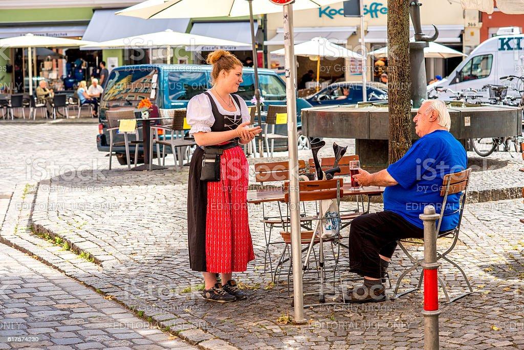 Bavarian waitress outdoors stock photo