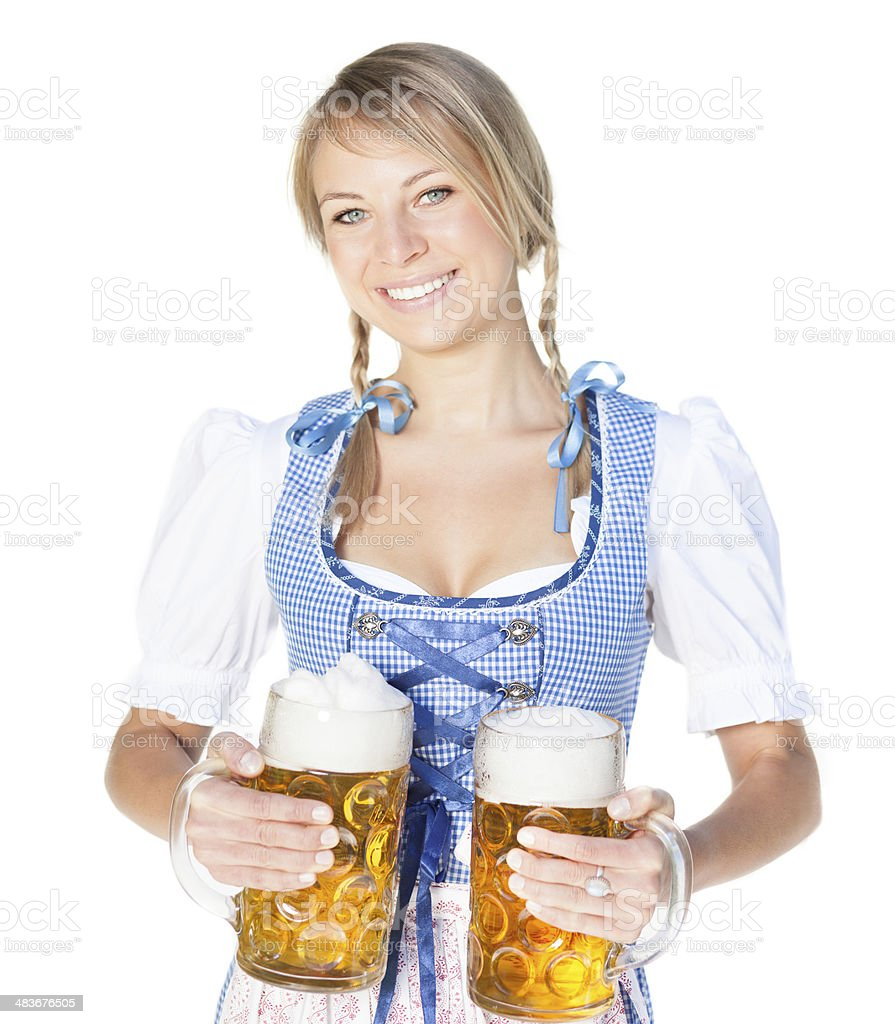 Bavarian Wiesn girl in dirndl with beer stock photo