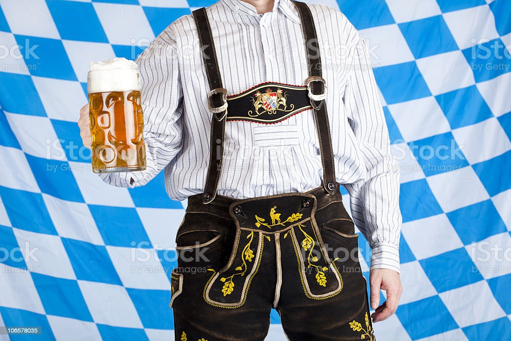 Bavarian with Oktoberfest beer stein (Mass) and leather pants (Lederhose) stock photo
