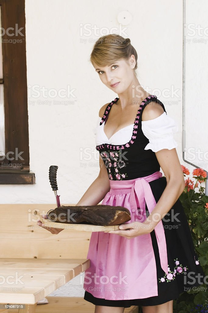 Bavarian woman in a dirndl royalty-free stock photo