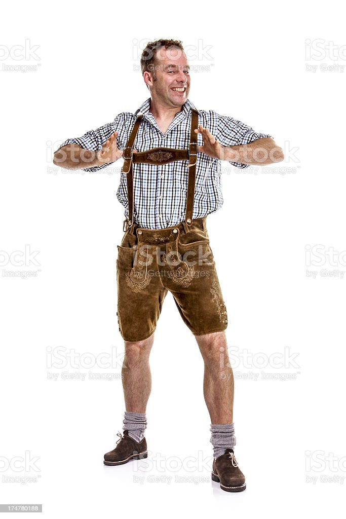 Bavarian/Austrian man snapping his suspenders stock photo