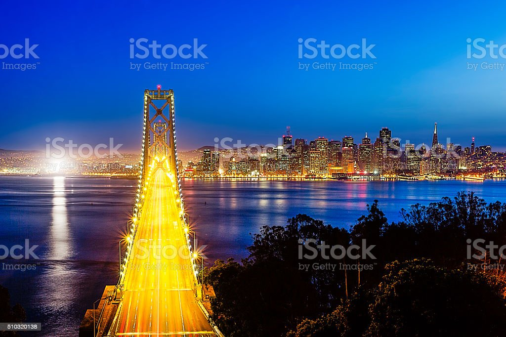 Bay Bridge with San Francisco Cityscape at Night stock photo