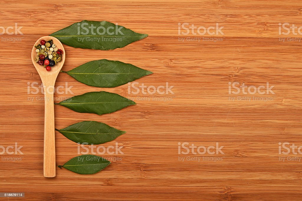 Bay leaves and peppercorn in spoon royalty-free stock photo