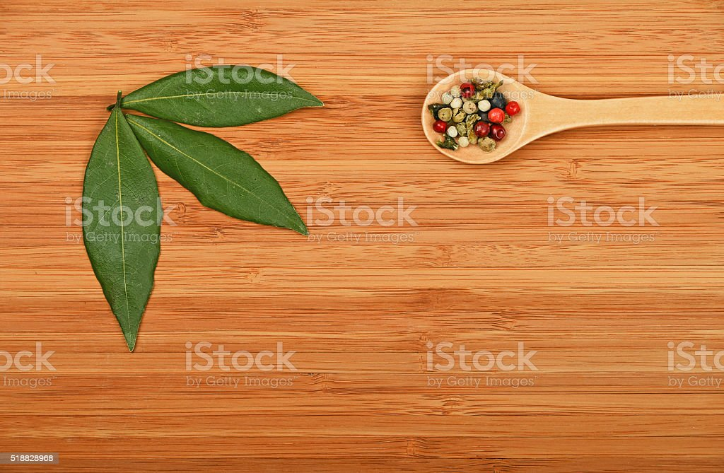 Bay leaves and peppercorn on wood royalty-free stock photo