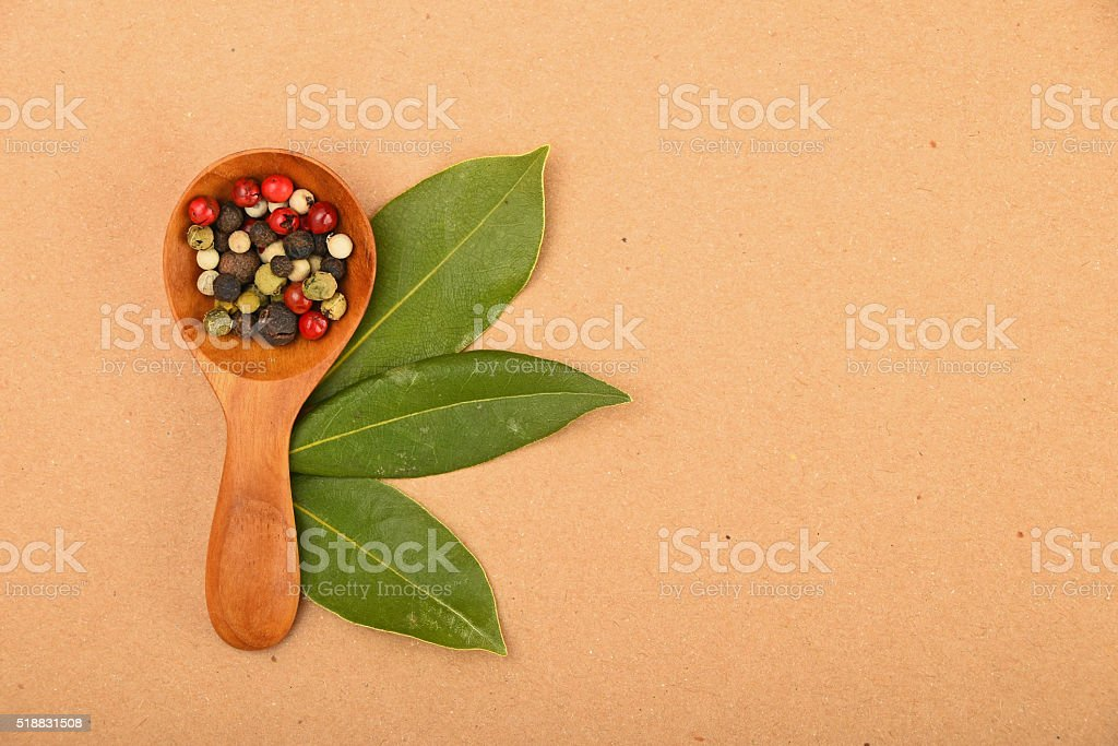 Bay leaves and peppercorn scoop on kraft paper royalty-free stock photo
