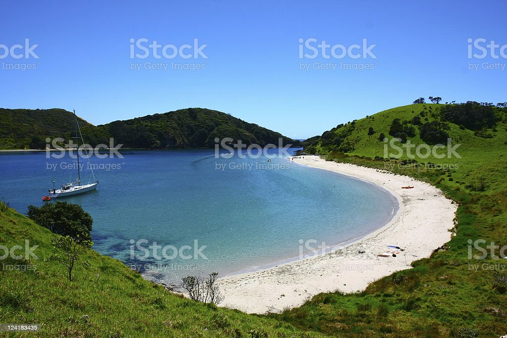 Bay of islands in New Zealand with a boat on the water stock photo