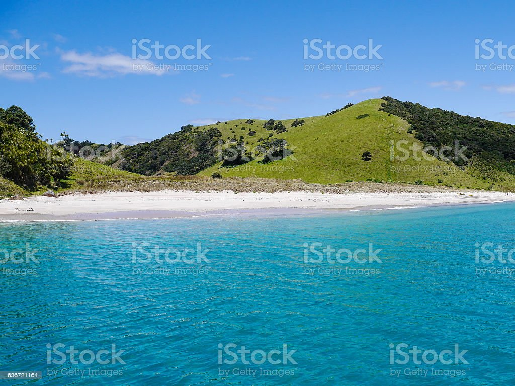 Bay of Islands - White Beach with green Hills stock photo