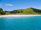 Bay of Islands - White Beach with green Hills