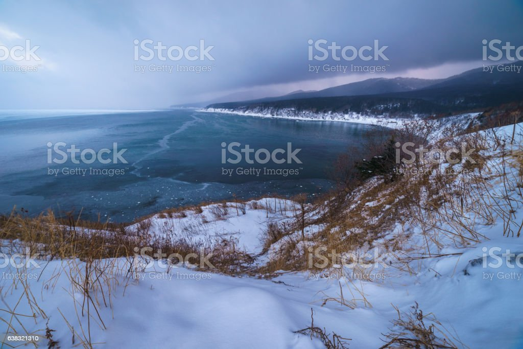 Bay of the Okhotsk sea through gloomy sunset, Sakhalin island stock photo