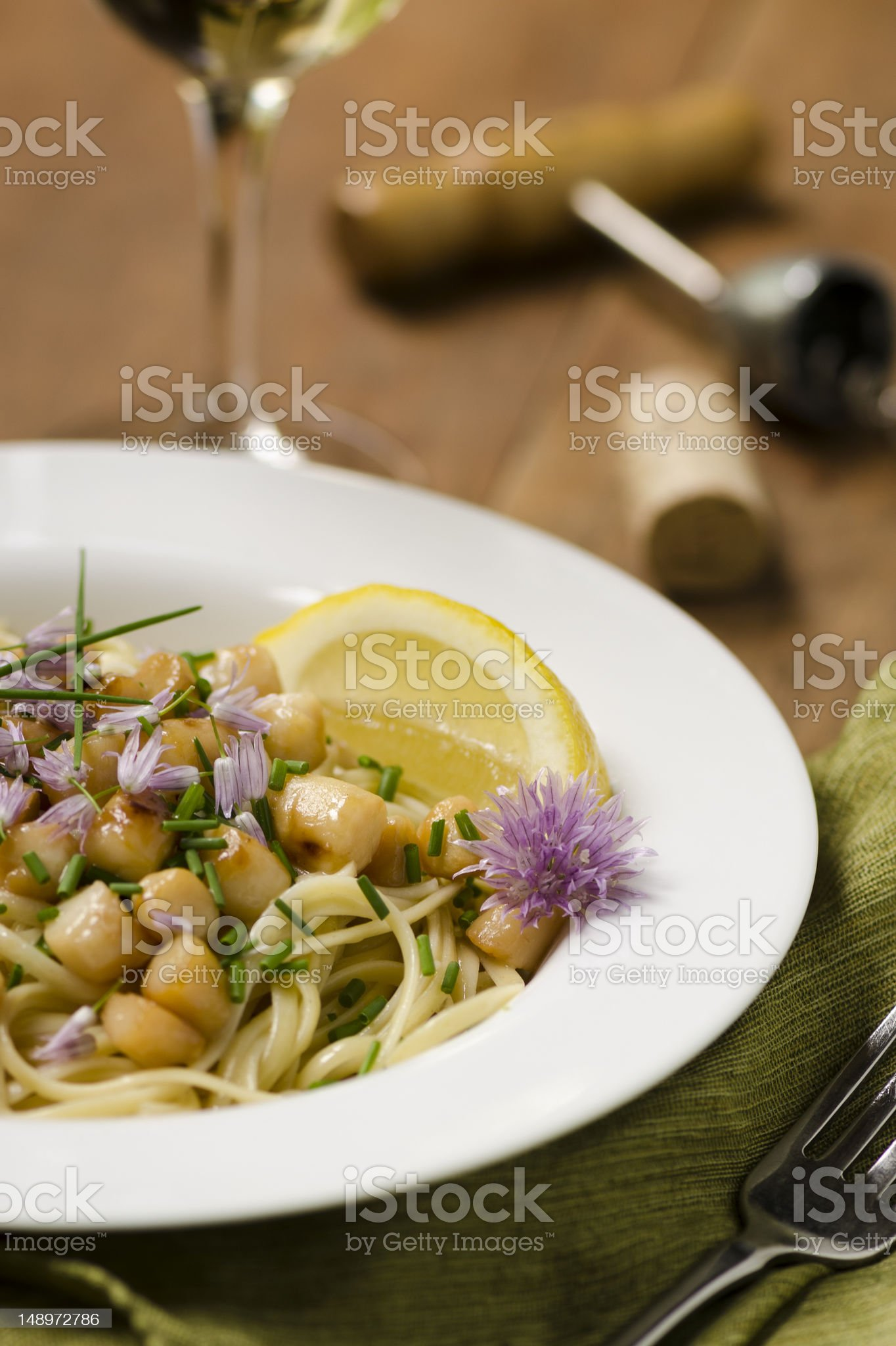 Bay Scallops over Linguine with Chive Lemon Butter Vertical royalty-free stock photo