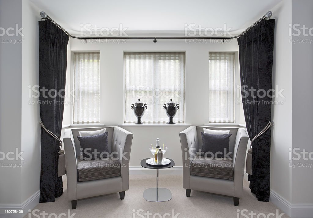 bay window and armchairs stock photo