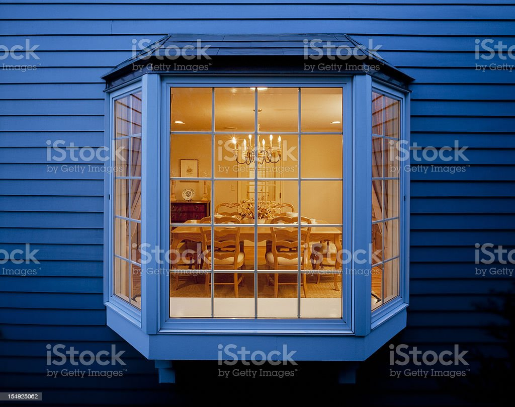 Bay window of dinning room seen from outside stock photo