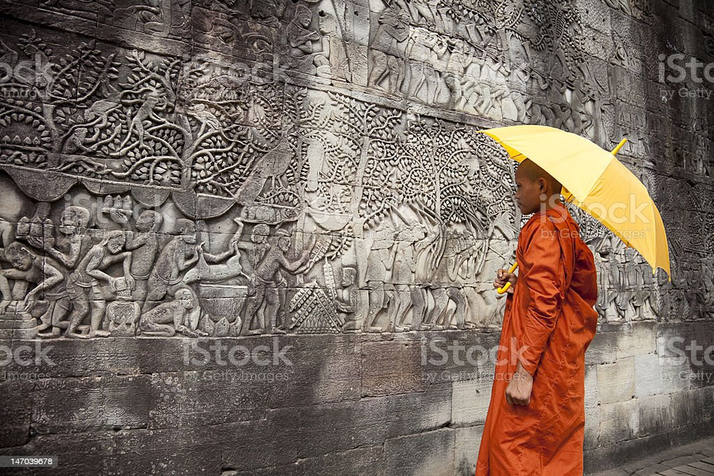 Bayon bas-reliefs with monk royalty-free stock photo