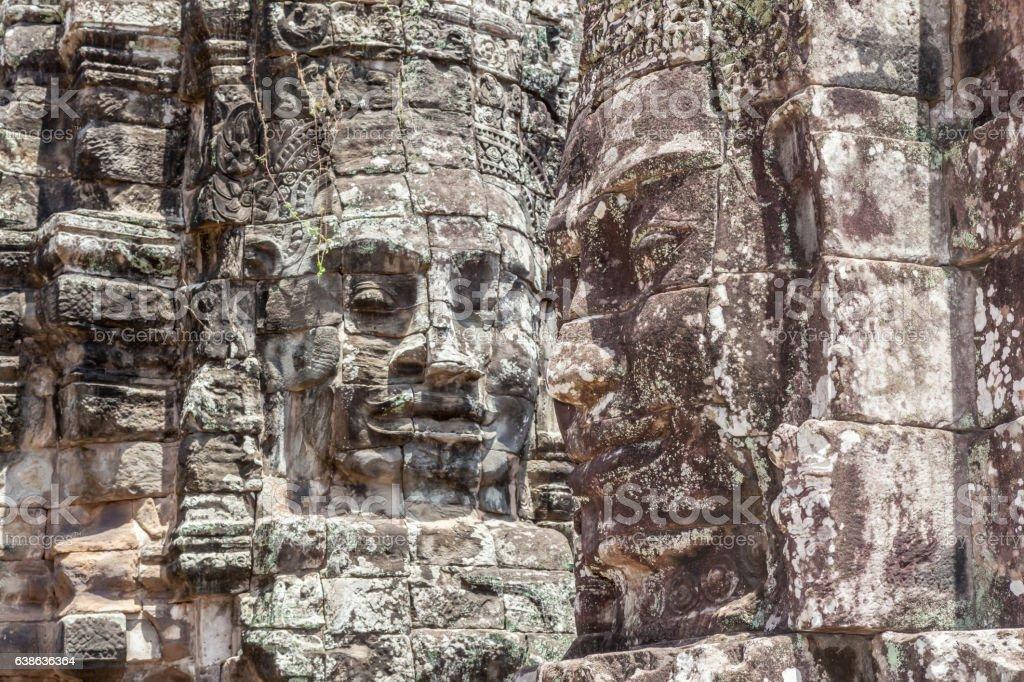 Bayon stone faces tower in Angkor Wat, Siem Reap, Cambodia. stock photo