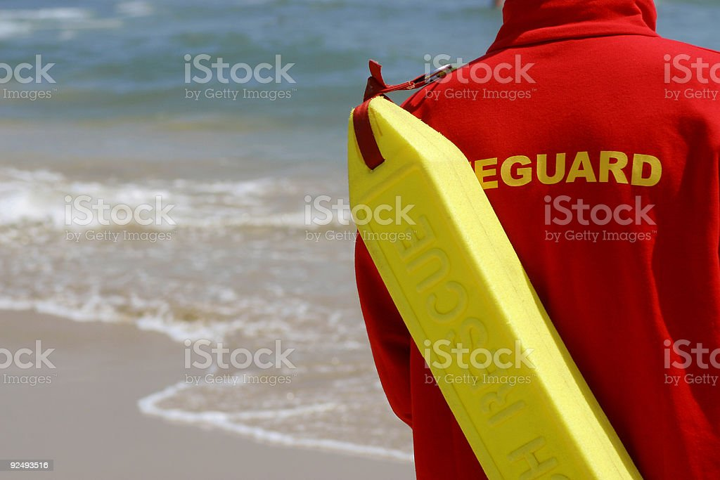 Baywatch Lifeguard With Float At A Beach stock photo