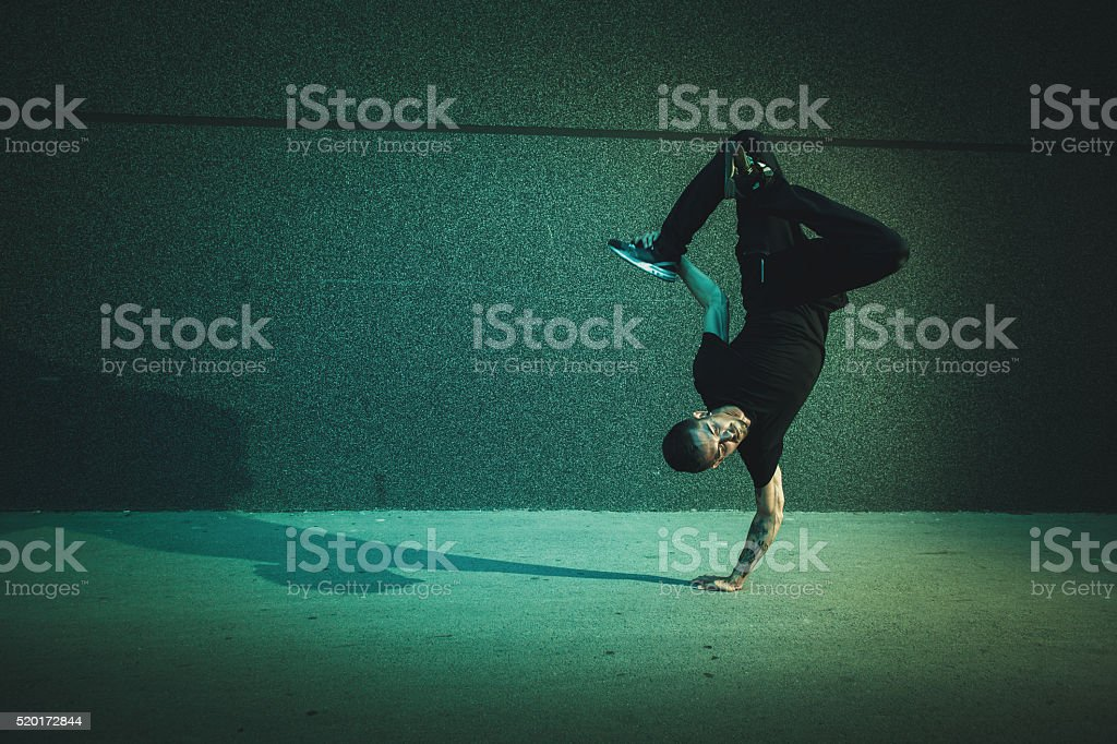 BBoy doing handstand on street stock photo