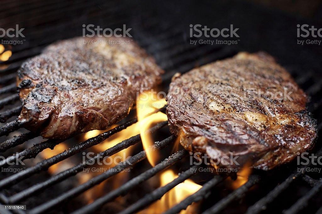 bbq ribeye steak grilling royalty-free stock photo