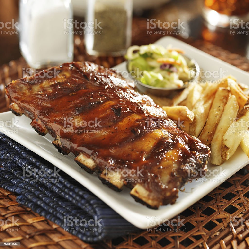 bbq ribs with cole slaw and french fries stock photo