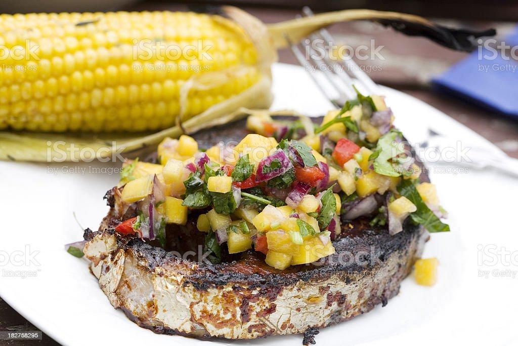bbq tuna steak with mango salsa and corn royalty-free stock photo