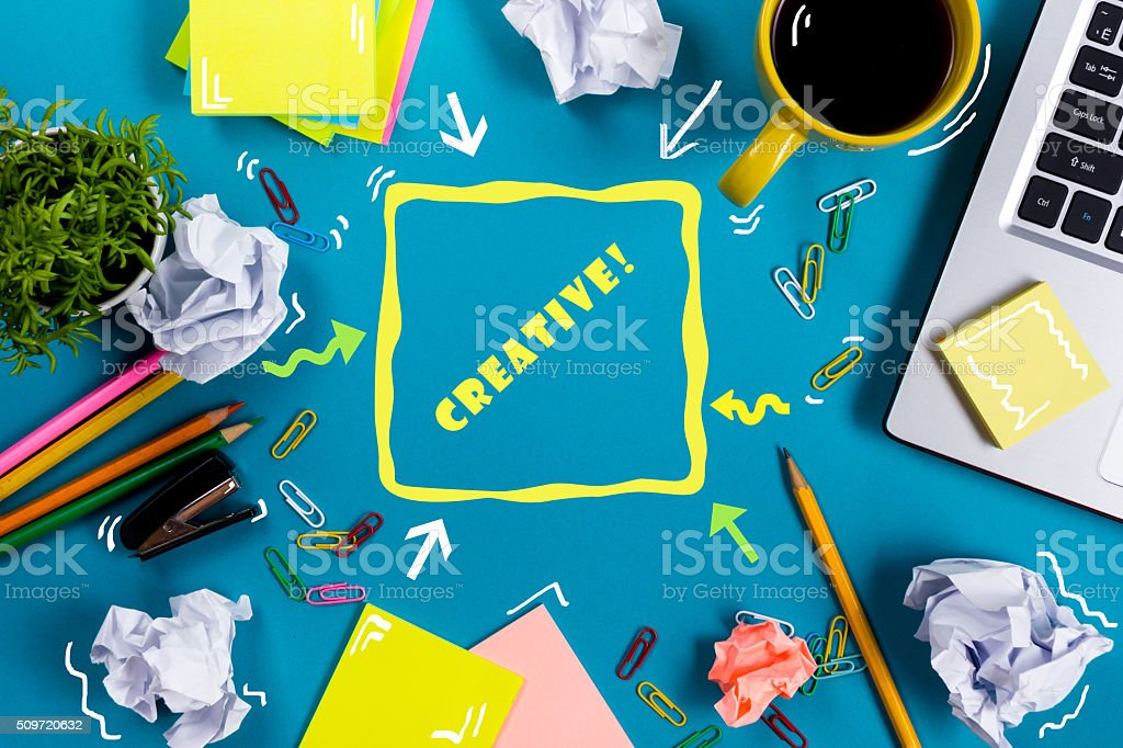Be creative word. Office table desk with supplies, white blank stock photo