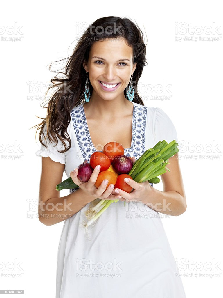Be vegetarian - Smiling young woman holding vegetable stock photo