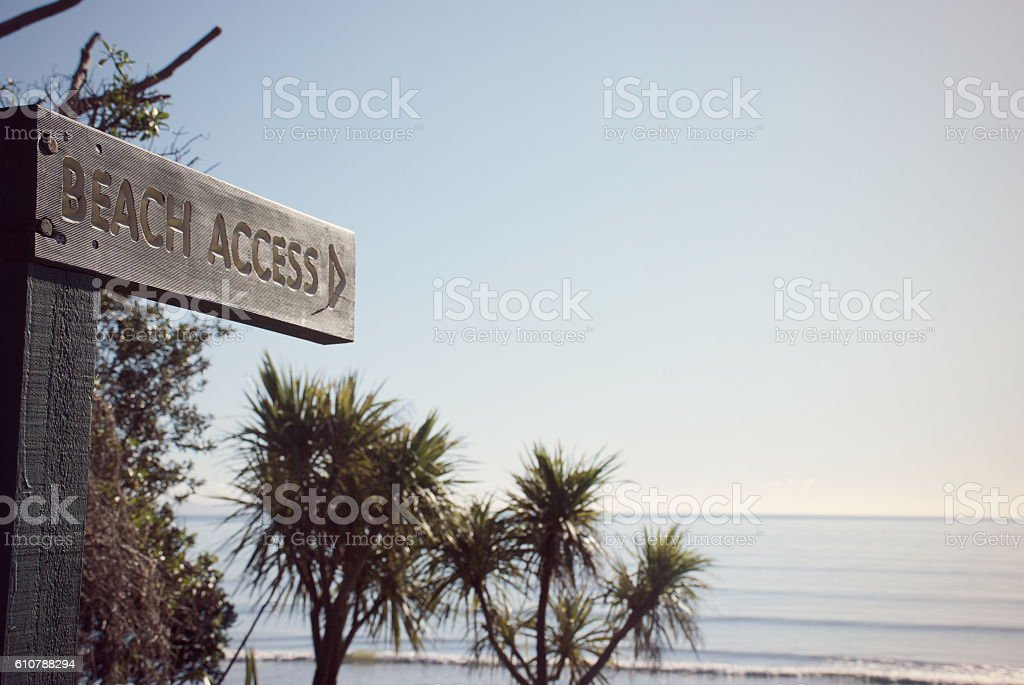 Beach Access Signpost with Ti Koukas, New Zealand stock photo